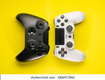 Black and White game controllers on yellow background