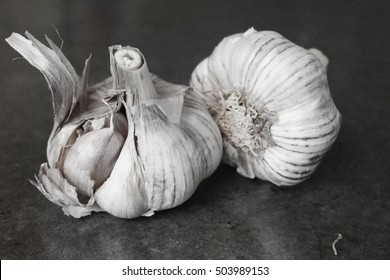 Black and white garlic in the black background