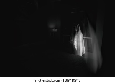 black and white ghost women in haunted hotel with double exposure and dark filter (halloween concept)