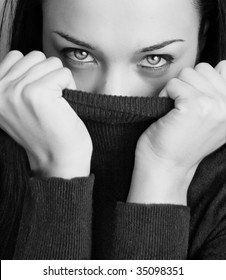 Black and white girl with half face tighting pullover