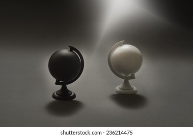 black and white globes divided apart