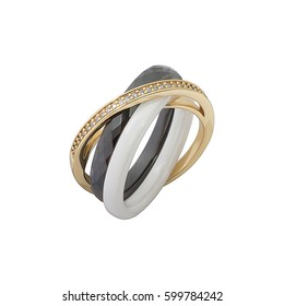 Black, white and gold jewelry ring assembled of several rings with fianits isolated on white background.
