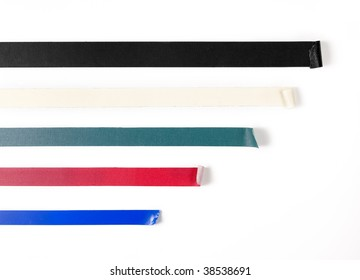 Black; white; green; red; blue tape isolated on white.