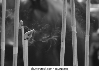 black and white grey scale incense with smoke