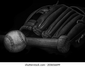 black and white grunge effect low key baseball bat, mitt glove and ball with space for text