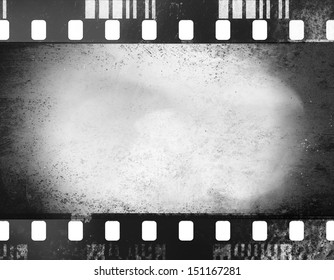 A black and white grunge film frame with white empty space inside