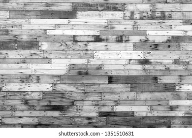 black and white grungy barn wood wall background.