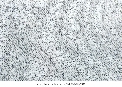 Black and White handmade knitted fabric. Knitting or knitted pattern texture with close up view.