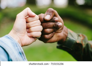 Black and white hands fist outdoor