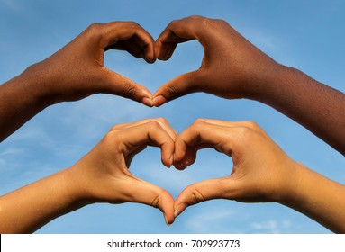 Black and white hands in heart shape, interracial friendship