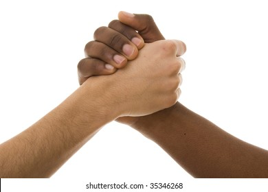 Black and white hands shaking in friendly agreement isolated on white