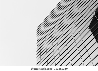 Black and white high building facades. Building Window in grid shape. Glass building Window. Abstract view. Architecture view.