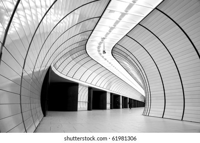 Black and white high contrast composition of the underground station in Munich, with interesting circular lines on walls