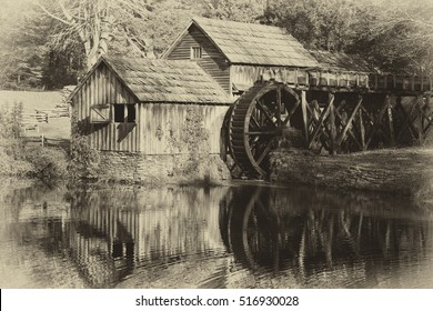 Black and white historic Mabry Mill on the Blue Ridge Parkway in Meadows of Dan, Virginia in the fall