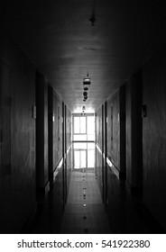 Black and white hotel hallway