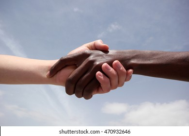Black and white human hands