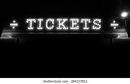 Black and white illuminated ticket sign.