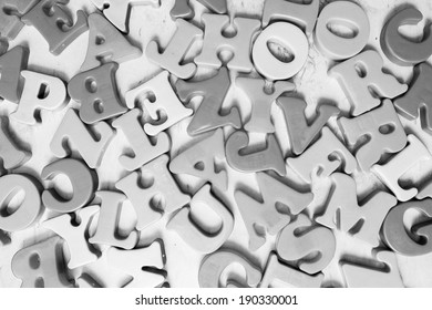 black and white image of alphabets scattered on a isolated background