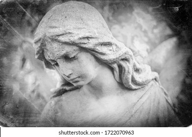 Black and white image of angel in the sunlight (antique statue)