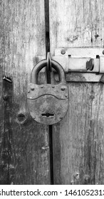 black and white image. antique lock closed the door