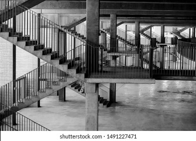 Black and white image with the architecture and various staircases and patterns inside a soccer stadium