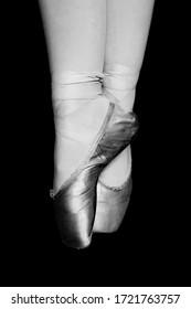 Black and white image ballet dancer en point