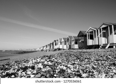 Black and white image of the beach huts at Thorpe Bay, near Southend-on-Sea, Essex, England