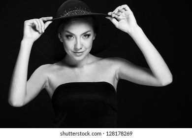 A black and white image of a beautiful young woman