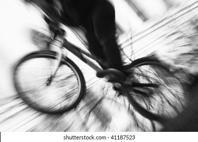black and white image of biker on bike in motion