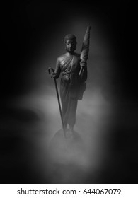Black and white image of Buddha statue.