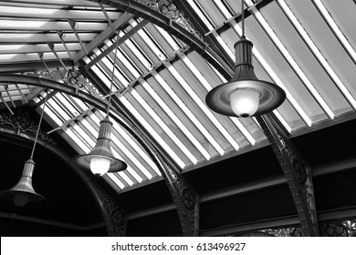 Black and white image of a ceiling and lighting