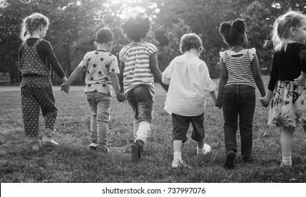 Black and white image of children walking at the park