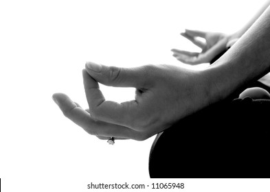 Black & White Image close-up detail shot of the Yoga hand position during meditation