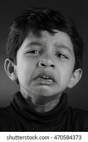 Black and white image of a crying boy