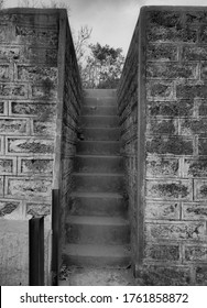 black and white image of an empty stairs in india village