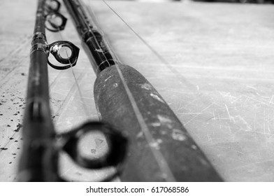 Black and white image of fishing equipment - line ring of a fishing rod
