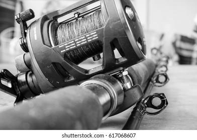 Black and white image of fishing equipment - the fishing set