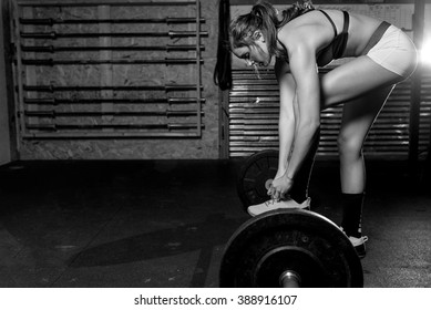 Black and white image of Fit woman working out at a gym.