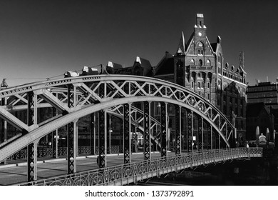 black and white Image of Hamburg's oldest bridge Brooksbrücke leading to famous UNESCO world heritage Speicherstadt