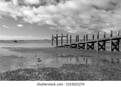 Black and white image of the Jetty on Jubilee beach, Southend-on-Sea, Essex, England