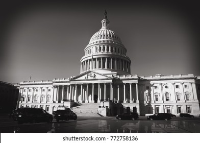 Black and white image of limousines parked by the National Capital building in Washington DC