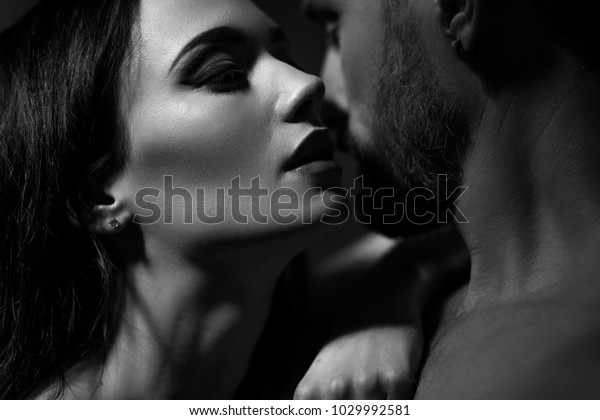 Black and white image of loving couple. Going to kiss.