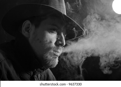 An black and white image of a man smoking cigar