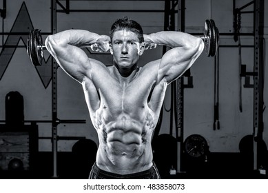 Black and White image of man working out in a gym