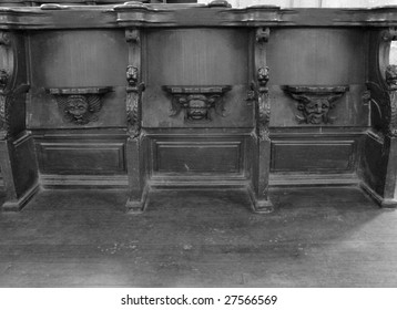 Black and white image of medieval wooden choir stalls in the Cathedrale Saint Pierre in Poitiers, France