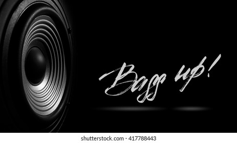 """black and white image of a membrane sound speaker isolated on a black background.  Photos contains handwritten text """" Bass up'"""