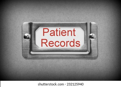 A black and white image of a metal drawer label holder with a white card and the title Patient Records added in red text