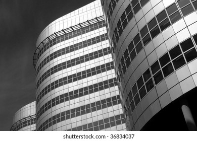 black and white image of modern curved buildings, located in Rotterdam