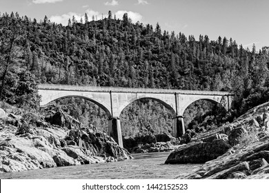 Black and White image of Mountain Quarries Railroad Bridge completed in 1912 ~ it crosses the American River in the foothills of the Sierra Nevadas in Auburn, California