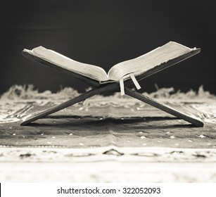 Black and white image of an old Holy Book